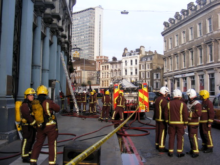 Firefighters outside the Hop Exchange