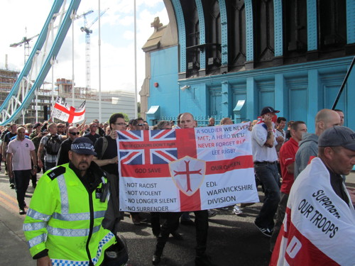 English Defence League supporters march across Tower Bridge