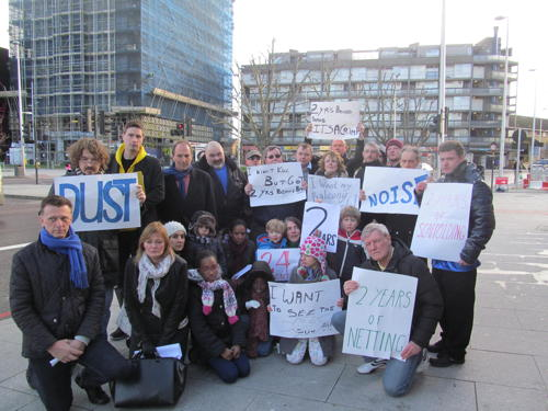2 years living behind scaffolding: Draper House residents protest