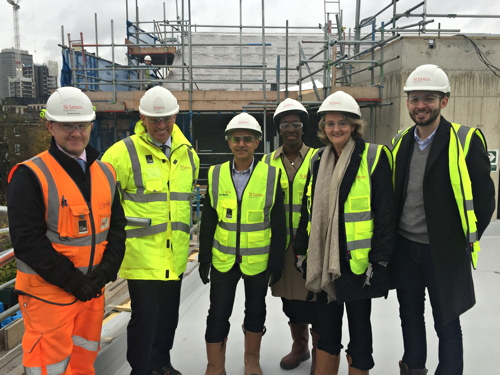 Sadiq Khan visits council homes funded by riverside luxury flats