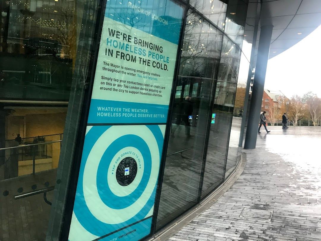 Tap on City Hall window and donate £3 to homelessness charities
