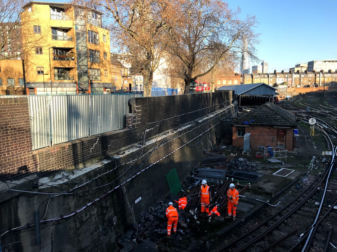 Car crashes into tube depot wall, scattering bricks on track